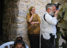 08-03-19 Israeli settlers (on left the daughter of Rabbi Moshe Levinger and on right David Wilder, one of the Hebron settler community leaders) in a Palestinian home. Shortly afterwards the Israeli military evicted the family.