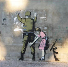 A picture of a little girl in a bright pink dress frisking an Israeli soldier