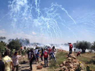ISraeli soldiers firing hundreds of tear gas rounds at protesters in west bank village of Ni'lin during commemorating 67th anniversary of Nakba. 15-05-2015